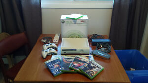 Xbox 360 60GB edition + 2 rechargeable controllers + 7 games
