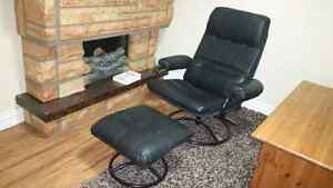 Black leather rocking spinning chair with leg stand, 70$ deliver