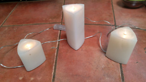 A set of 11 fake candles on switches