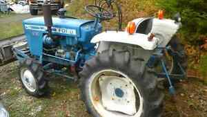 Ford compact tractor with full hydraulic plow