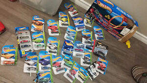25+ Hot wheels in boxes and track