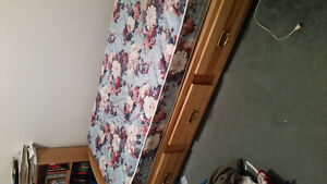 Wooden bed frame and mattress