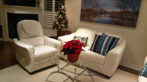 white bonded leather love seat