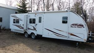 31' Heartland trailer with 2 power slides 1/2 ton pullable