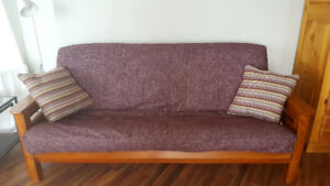 Solid wood couch - in great shape - works as sofa bed