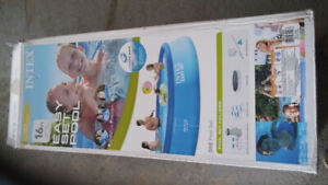 Intex  16 ft round pool + accessories.