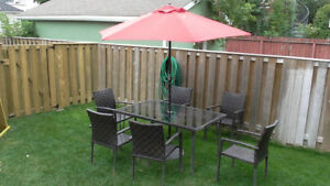 Patio table, 6 chairs and umbrella
