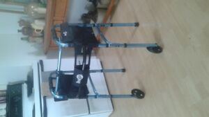 Good quality 2 wheel walker with storage bags .
