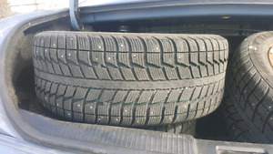 set of four  205 55 16 winter studded tires  on rims 5x114.3