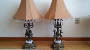 A pair of antique Italian cherub lamps