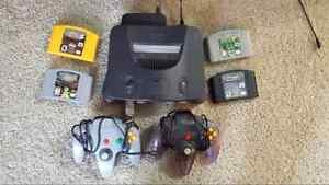 N64 console with controllers and games.