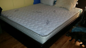 Queen bed frame and mattress for sale.