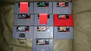 Snes in box with Styrofoam and manuals with 8 games