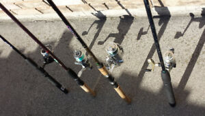 4 FISHING RODS  WITH  REELS