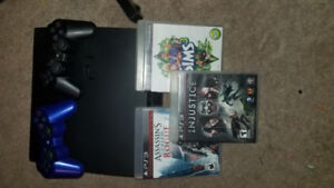 PS3 Slim perfect condition with games and 2 controllers