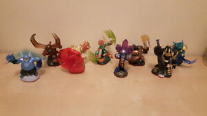 Skylander Trap Masters for each element including dark / light