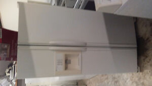 Big side by side fridge and stove