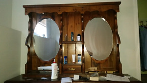 ANTIQUE DRESSER WITH A DUAL MIRROR MOUNT