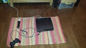 Used PS3 with controller, camera, move controller and 21 games