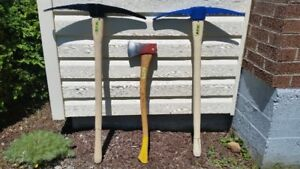 TWO PICK AXES  IN GOOD CONDITION