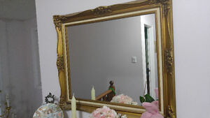 WALL MIRROR WITH A GOLDEN FRAME