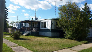 Mobile home with lot in Donnelly