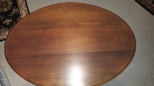 Oval solid wood coffee table