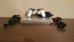 PS2 with Memory Card 1 Controller and 2 Games