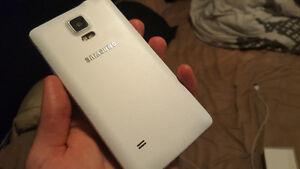 Beautiful Samsung galaxy note 4 with box and everything London Ontario image 3
