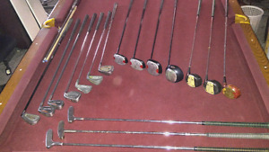 Wilson golf bag and asorted clubs