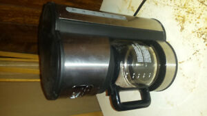 Oster stainless 12 cup coffee maker.