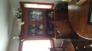 Dining room table with 6 chairs and matching buffet.
