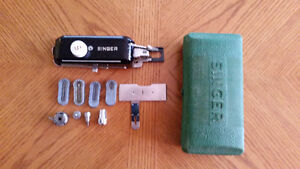 Vintage Singer Sewing Machine button holer & box of attachments.