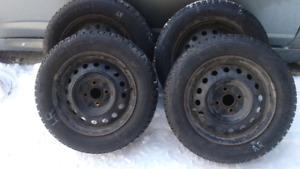 $300/4 Michelin X-Ice Tires on rims.  175/65/R14  4 Bolt pattern