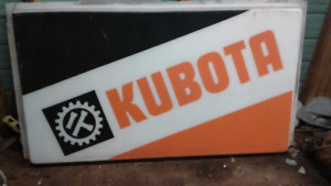 Vintage kubota tractor dealership sign.