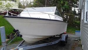 Sea worthy boat, motor, trailer package
