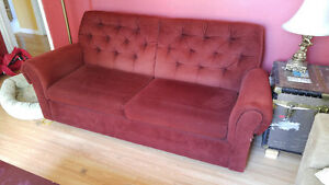 Red pull-out couch