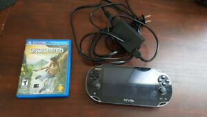 PlayStation Vita System and Uncharted Golden Abyss game