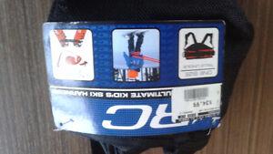 Harnais de ski pour aider jeune enfant à skier