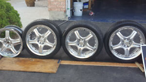 Selling 4 rims and 3 tire