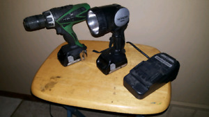 Hitachi 18 volt cordless drill with flashlight and batteries.