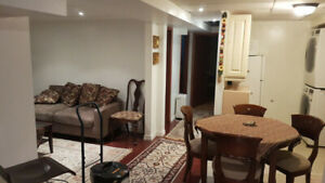 Large Room in Fully Furnished Basement Apartment for Rent