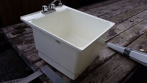 laundry tub with faucet and drain