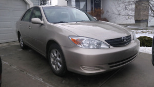 2004 Toyota Camry LE V6, 182k, no accidents.