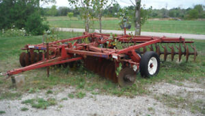 Massey Furgeson Disc Plow and International Furrow Plow