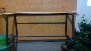 Metal tire rack for wall for sale.  $25