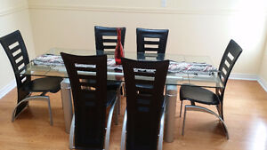 Glass dinner table with 6 leather chairs