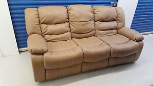 Real leather, mint condition white recliner couch with delivery!