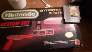 Nintendo from 1985 in the box .extra game .mint shape works 1 cl