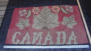 Antique hooked rug with Canada Motif